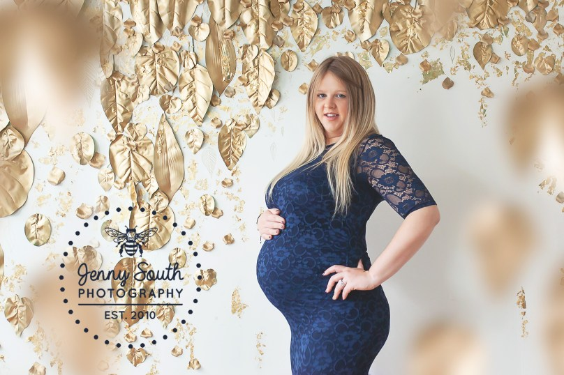 A Mum to be smiles softly during her maternity session against our exclusive Joyful Gathering set