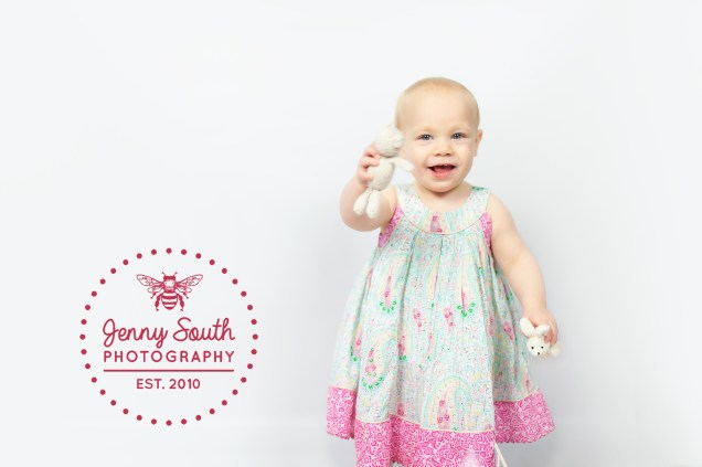 A little girl plays with teddies during her photo shoot at the Jenny South photography studios