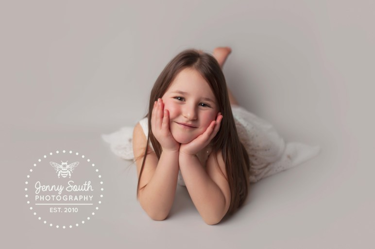 A sweet girl poses during a family photo shoot in Plymouth
