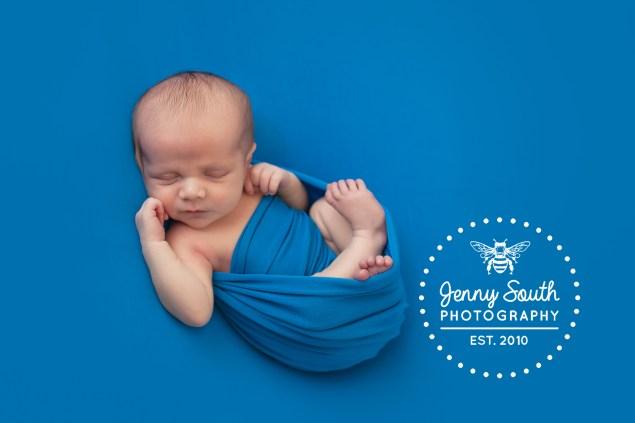 A beautiful newborn bundle all in blue.