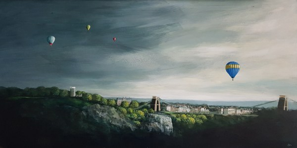 A hot air balloon floats of Clifton in Bristol ahead of a storm by Jenny Urquhart