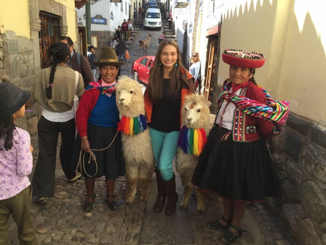 Posing with llamas in Cusco