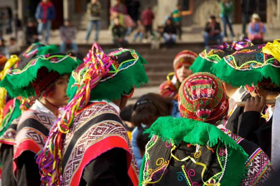 Attendees in costume at a Peruvian festival