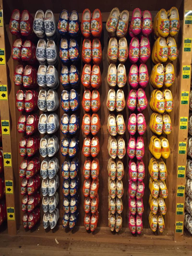 Clogs displayed on a wall