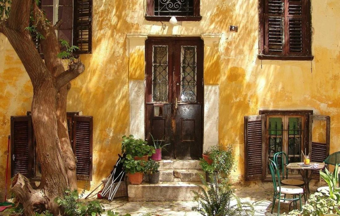 Facade of yellow house in Athens, Greece