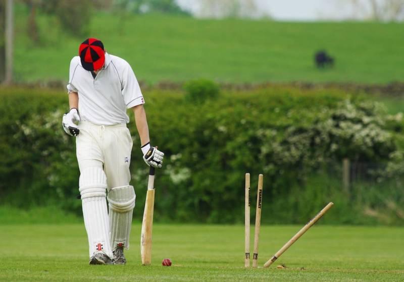 Man playing cricket