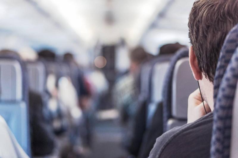 Man sitting on a plane