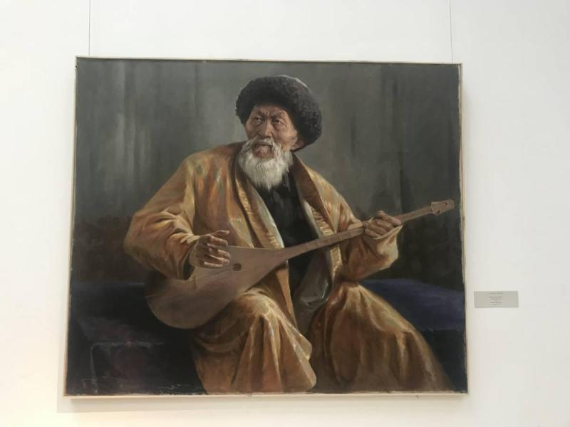 Painting of Kazakh man holding instrument