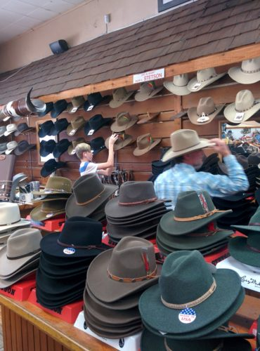 display wall of ten-gallon stetson hats and table full of hats fm light store steamboat springs co jenphotographs
