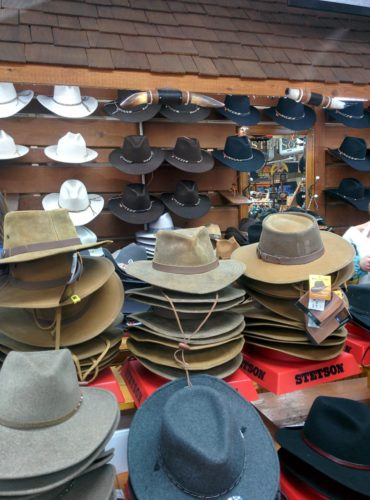 Display wall of hats and table full of hats - different section fm light store steamboat springs co jenphotographs