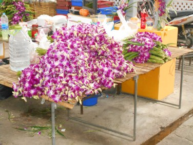 Flowers waiting to be tied into bunches and temple offerings