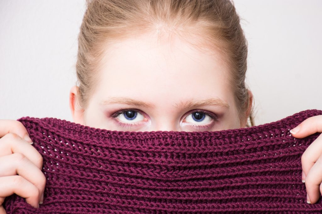 woman hiding
