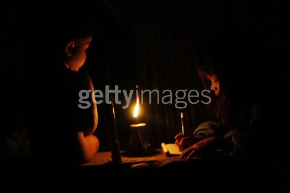 MANILA, PHILIPPINES - JUNE 19: Filipino Muslim kids, among the tens of thousands people displaced in the ongoing fighting between Philippine security forces and Muslim separatist rebels, study inside their tent night of June 19, 2009 in the restive Maguindanao province, 960km south of Manila. Fighting between the Moro Islamic Liberation Front (MILF), the country's 11-900-strong rebel group and Philippine military troops began August 2008 when the rebels launched series of attacks across several villages due to aborted signing of a deal that would give them their homeland. Around 300 people died but displacing over half a million more in the initial attacks and fighting which has followed. The Norwegian Refugee Council, an independent humanitarian non-governmental organization engage in providing assistance, protection and durable solutions to refugees and internally displaced persons worldwide, recently reported the Philippines was the most neglected displacement situation last year. The council said the world's largest new displacement last year happened when 600,000 people fled fighting between Philippine troops and Moro rebels in Mindanao. The MILF Muslim separatist rebel group are fighting for an independent Islamic state in the southern Philippines. (Photo by Jeoffrey Maitem/Getty Images)