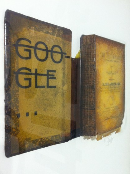 Rero. Google. Vinyl letter and resin on antique book. 2011. Collection of C Laurier, courtesy of Backslash Gallery.