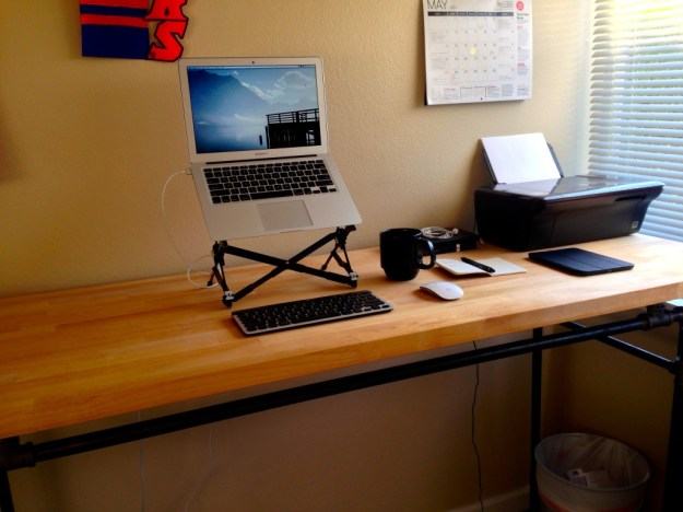 This is from home, but here's what my mobile setup looks like: Roost stand, MacBook Air, Logitech wireless keyboard, and Magic mouse.