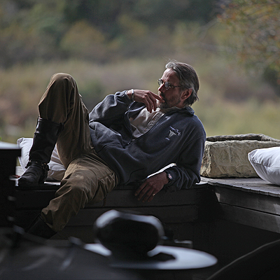 Jeremy Irons in a moment of reflection at the Singita Sabi Sand Game Reserve during the 2009 International Achievement Summit in South Africa.
