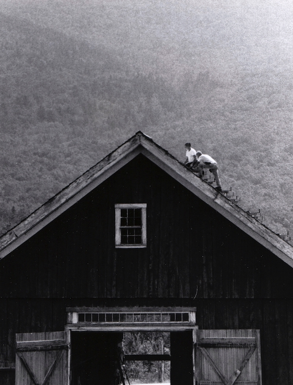 Farmers fix the roof of their antique barn – from Jeremy Larochelle's photo portfolio.
