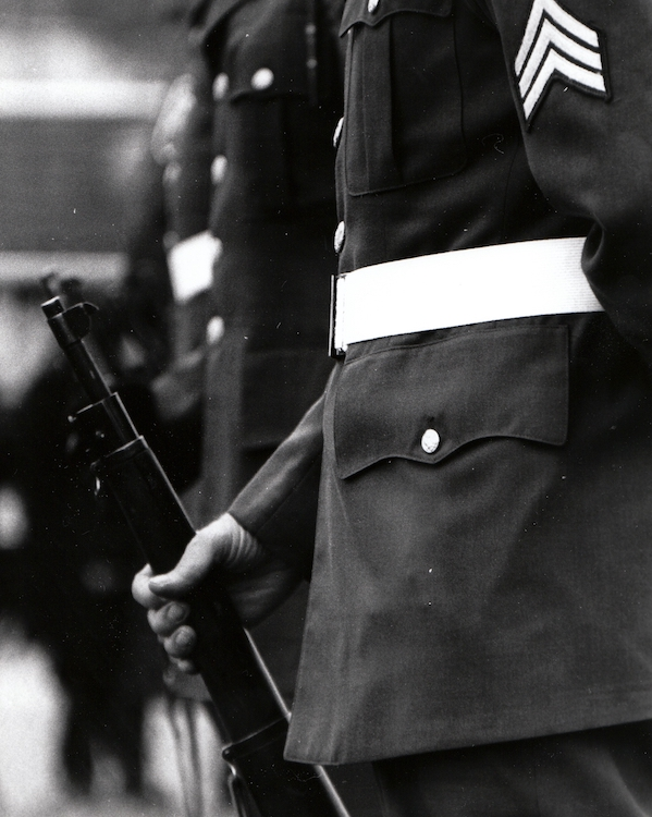 A veteran holds his weapon during a Memorial Day Parade– from Jeremy Larochelle's photo portfolio.