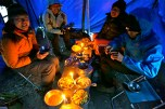 The team having a feast at base camp