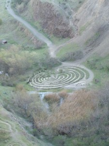 The Labyrinth symbolizes the  journey to our own center and back again out into the world.
