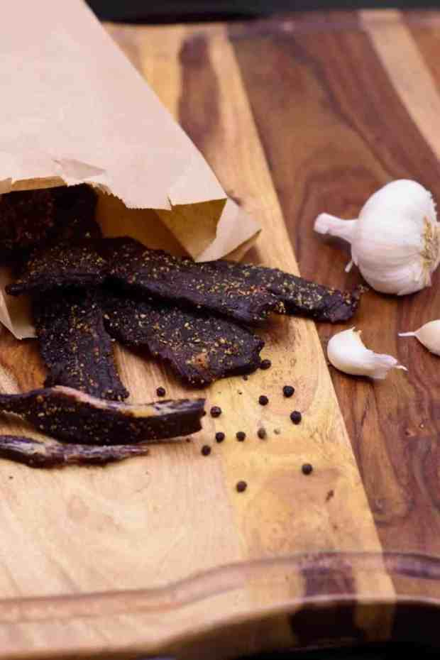 Fire up the smoker and get ready to make a tasty peppery beef jerky. | Jerkyholic.com