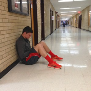 Austin Yeakey, junior student at Central Michigan, sits in Pearce hall with bright red shoes and red shorts. Photo by: Jermaine Fields