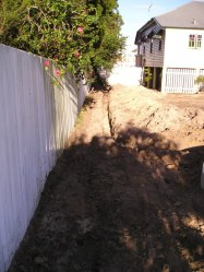 After the rain tank was installed this trench had ag pipe laid in gravel running from the overflow.