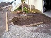 The soakaway, block retaining wall and gravel lining.