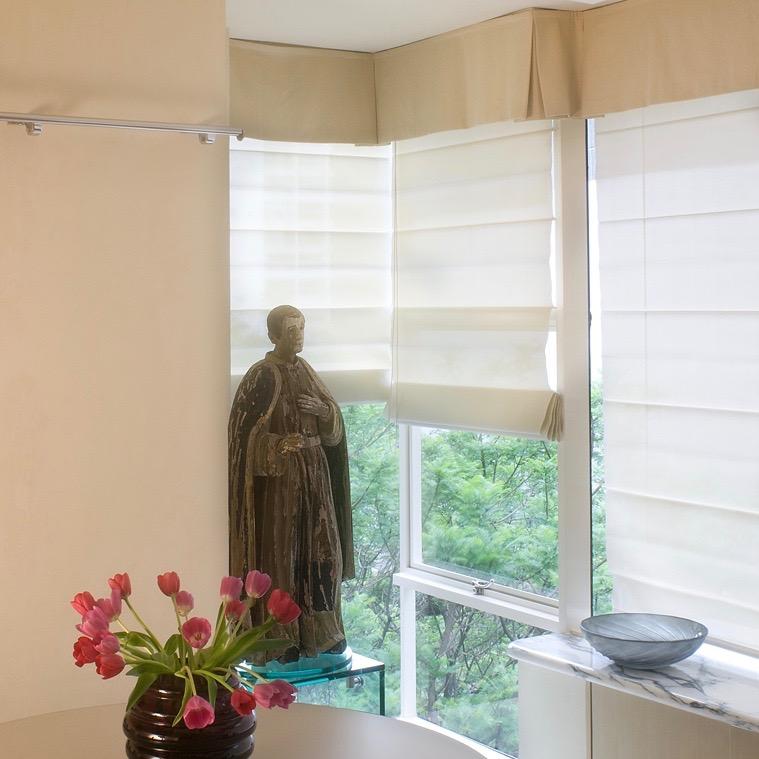 Window treatments. Roman sheer corner.