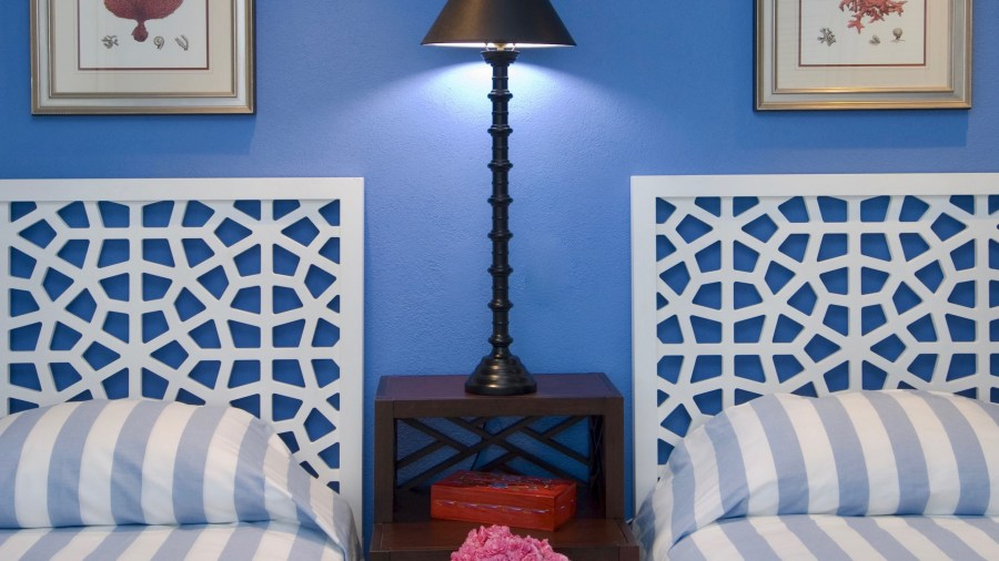 Trellis headboards and blue wall.