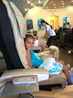 The chair is twice her size for the first mani pedi