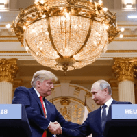 Trump and Putin shake hands during a joint press conference at the Helsinki summit.