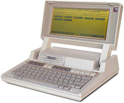 A heavy, chunky laptop computer from the early 1990s.