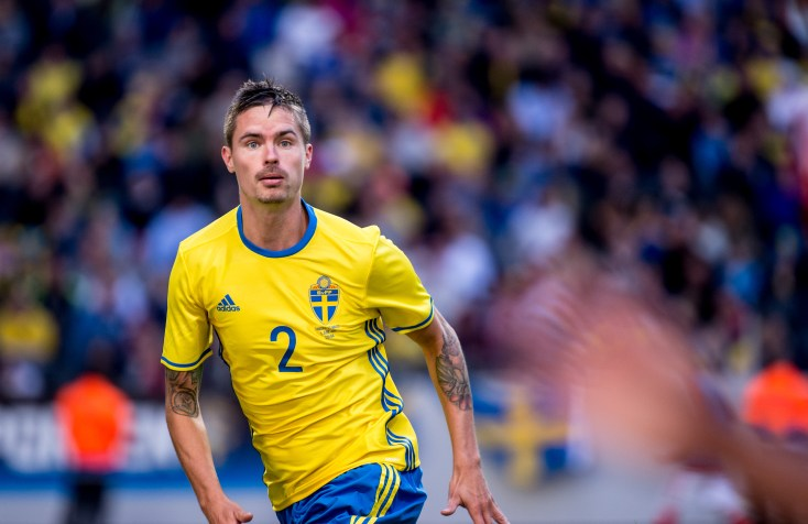 Mikael Lustig is keeping his eyes on the sprinting Wales player during a friendly game between Sweden and Wales on June 5th 2016 in Stockholm.