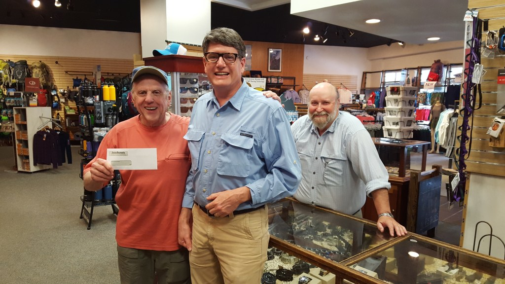 Steve Patterson from Project Healing Waters accepts a check from Jess Brown's Bill Bartee and Don Yager.