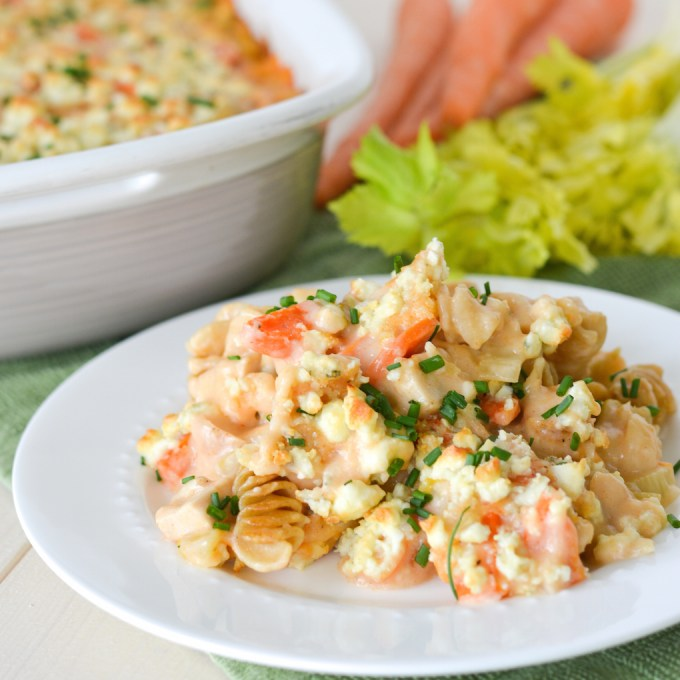 This Buffalo Chicken Casserole is like a Buffalo Chicken Mac 'N Cheese... with a creamy, spicy sauce, lots of carrots and celery, and melty blue cheese on top!
