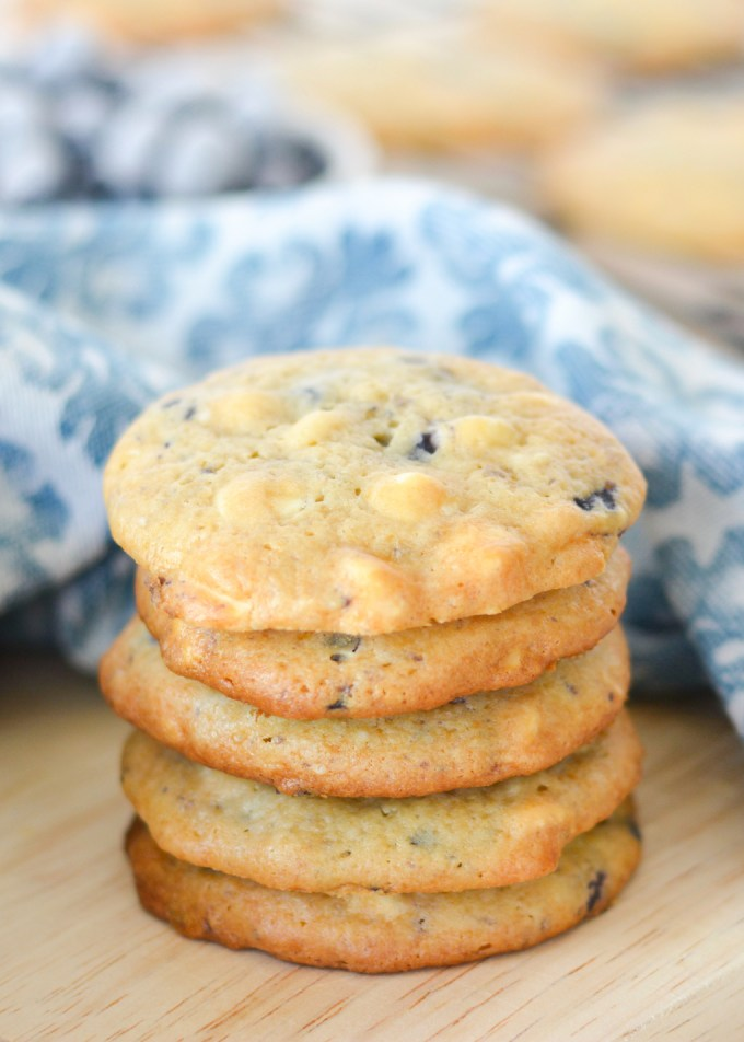 These Blueberry Cheesecake Cookies are made with a secret ingredient-- blueberry muffin mix! They're perfectly chewy and studded with white chocolate chips!