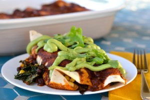 Black Bean and Kale Enchiladas with Avocado Cream and Homemade Enchilada Sauce