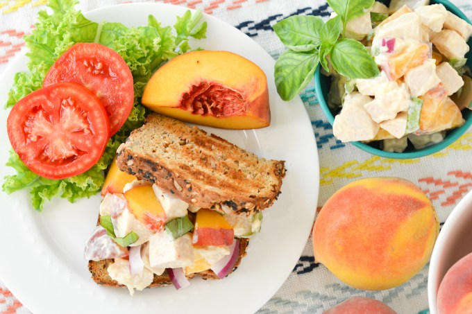 This chicken salad is bursting with the fresh summer flavors of ripe peaches and spicy fresh basil.