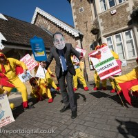 Giant chickens opposing a US trade deal visit the North Somerset constituency surgery of Liam Fox MP, protest organised by Global Justice Now highlights the concern that hormone-filled, chlorine-washed meat will flood British markets.