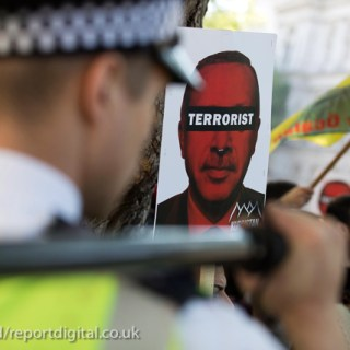 Kurdish activists protesting on Whitehall against Theresa May of welcoming Tayyip Erdogan, they accuse of being a war criminal, to Downing Street, London.