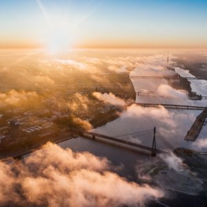 Aerial view of a city and river through the clouds