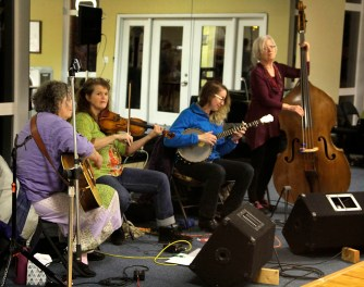 Lucy Allen, Amy Buckingham, Brooke Lauer, and Nancy Hamilton (left to right) of Battleaxe provided live contra music for the Emerald Ballroom's contra dance event Saturday, February 18.