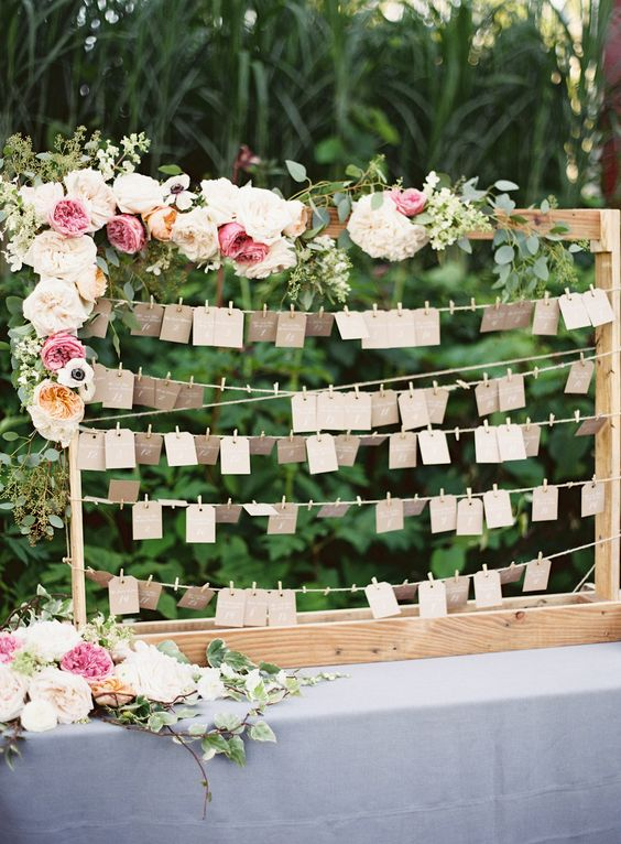 Escort Card Display with Corner Floral Arrangement | 11 Tips to Personalize Your Wedding - Jessica Dum Wedding Coordination #weddingtips