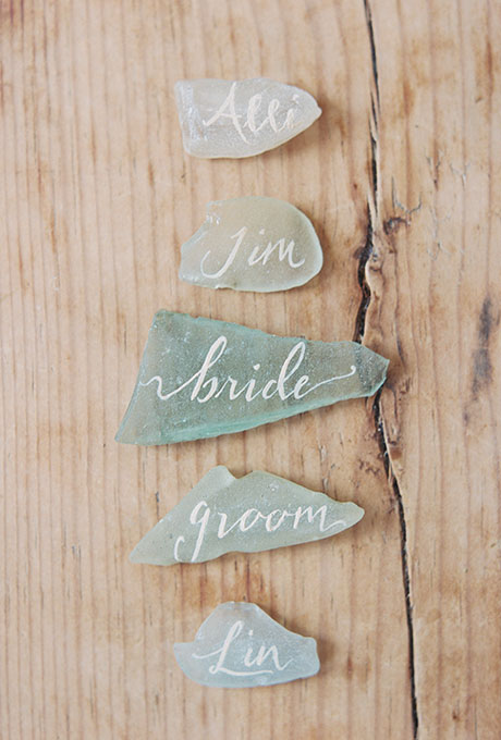 Hand-lettered seaglass wedding escort cards | 11 Tips to Personalize Your Wedding - Jessica Dum Wedding Coordination #weddingtips