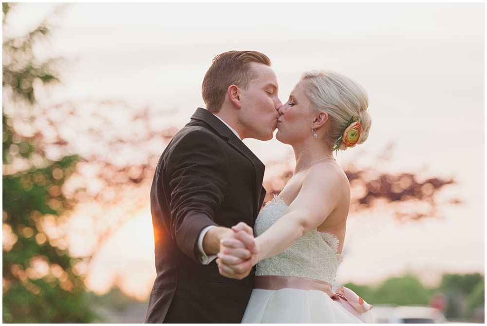 Bride and Groom kissing at sunset   Ritz Charles Garden Pavilion Wedding by Stacy Able Photography & Jessica Dum Wedding Coordination