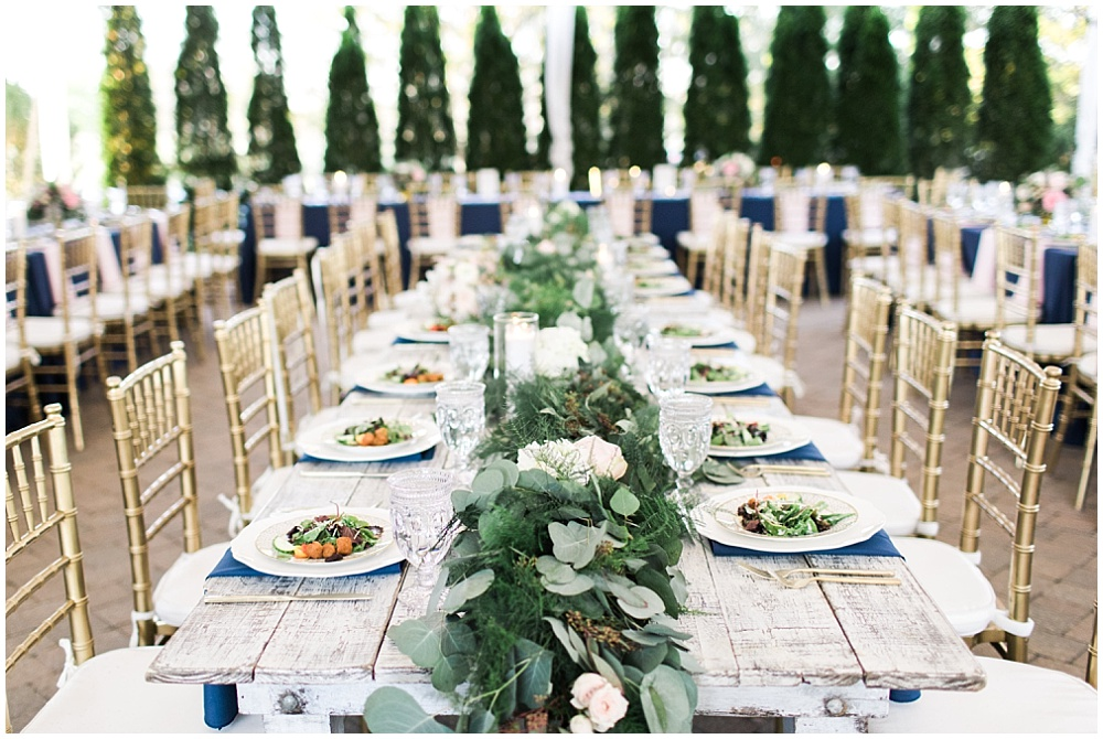 Farmhouse tables with draped greenery, navy and pink southern wedding   Ivan & Louise Images and Jessica Dum Wedding Coordination