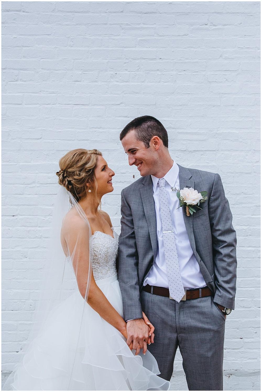 Bride and groom white brick wall   Chicago urban rustic wedding   Sandra Armenteros Photography + Jessica Dum Wedding Coordination
