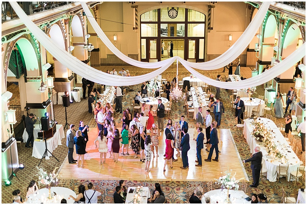 drapery wedding reception; dancing; dance floor; Mexican inspired gold & floral wedding; Crowne Plaza Indianapolis Downtown Union Station; neutral floral and greenery wedding|Cory + Jackie and Jessica Dum Wedding Coordination