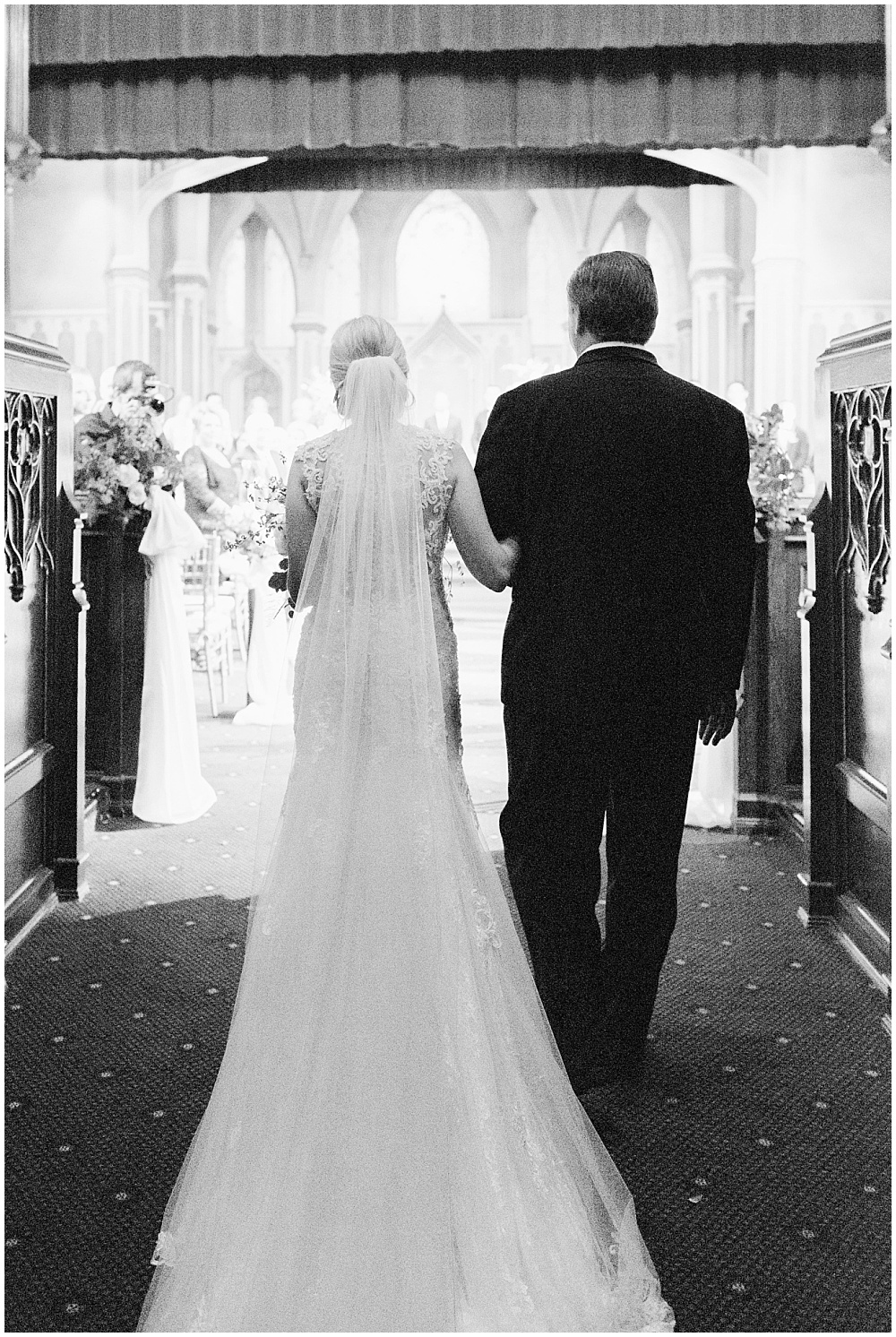 Bride and father of the bride walking down the aisle; Scottish Rite Cathedral Indianapolis Wedding; neutral floral and greenery wedding| Ivan & Louise Images and Jessica Dum Wedding Coordination